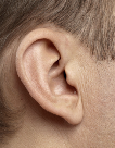 Image of a person wearing an invisible in canal hearing aid